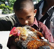 The boy and his rooster by Arte Moris