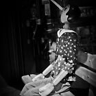 Pinocchio on the chair by Keiro