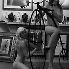 Nudes on Penny Farthing by catwalk