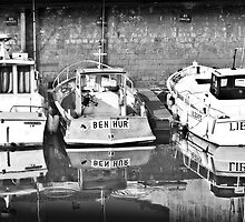 Reflection of boats in the harbour at  Ile De Ré by James Fox