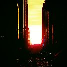 Manhattanhenge Sunset in New York City Looking Down 42nd Street by Vivienne Gucwa