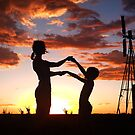 Silhouette Playing... Free State, South Africa (Captured with a Sony Ericsson C903)  by Qnita