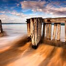 Through the fence - Raafs Beach by Hans Kawitzki