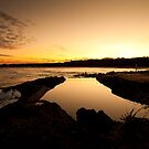 Sunset over the rock pool by Trish O'Brien