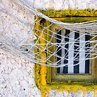 Sète - Yellow window and fishing net. by Jean-Luc Rollier