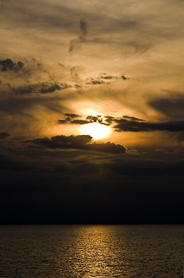 Sunset Breaking Through The Clouds by Adam Kennedy