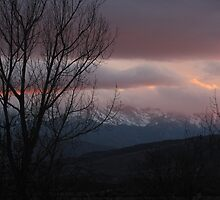 """Winter Clouds Low At Sundown Over Pike's Peak"" by dfrahm"