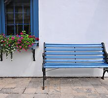 Bench and flowerbox, St. Jacobs by AskinImages