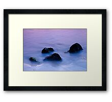 Stones in sea water Framed Print