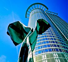 Modern office building with sculpture in Frankfurt, Germany by ingojez
