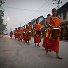 Morning alms ceremony in Luang Prabang by michael j.  connolly