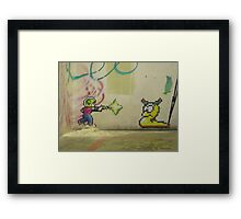 Little PIxel Guy and Worm Framed Print