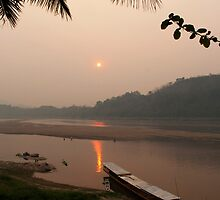 sunset over the mekong river by michael j.  connolly
