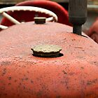 Raindrops on the hood of an old tractor by Jim Orr