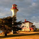 lighthouse evening break in summer rains by TerrillWelch
