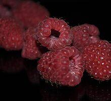 Ripe red plump juicy raspberries by Sianwestern
