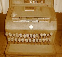 Old cash register in Sepia by Zeefive Photos
