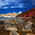 red beach and blue sky by plamenx