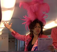 Karaoke in the train on Pink Monday by Hans Bax