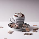 Cup of money by Robby Ticknor