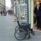 wheelchair left outside shop by H J Field