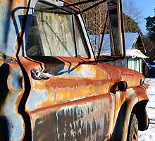Side View of abandoned truck by ashley hutchinson
