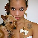 Girl holding Yorkie by Lauren Neely