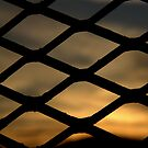 Sunrise Behind Fence by TylerBelisle