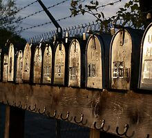 mailboxes in a row by Jon Helgason