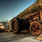 Tractor on the beach  by Rob Hawkins