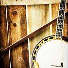 Vintage Banjo against barn wall by Jennifer Westmoreland