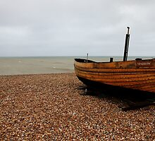 Lone boat on the shore of Dungeness by capelston