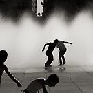Children in playing in a fountain,  Mexico City by Sed Miles