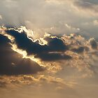 Sun beams bursting through the clouds by Maxim Mayorov