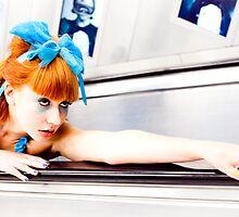 Girl on an escalator by Sendall