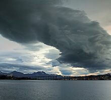 Dark clouds over the city by Frank Olsen