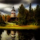 A church by a lake II by Juhana Tuomi