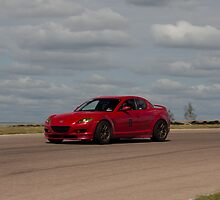Trevor K. Silva's Mazda RX8 at Turn 14, Heartland Park Topeka Road Course by Paul Danger Kile