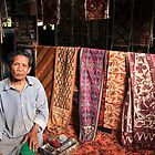 local man from tenganan selling ikat textiles, bali by nicole makarenco