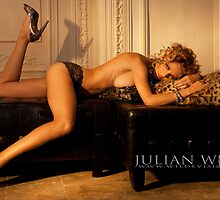 Anghelika on the Leather Ottoman by Julian Wilde
