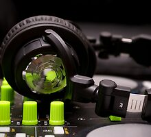 Headphones on a DJ Mixer by Mykhaylo Ryechkin