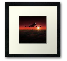 Airplane in the sky at sunset Framed Print