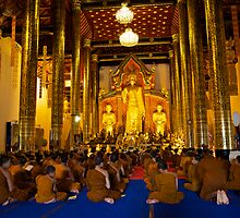Morning prayers, Wat Chedi Luang Chiang Mai, Thailand by John Spies