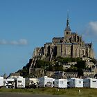 Campervans parked beneath Mont Saint-Michel, France. by Sami Sarkis