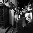 Walker at night, Tokyo by Alan Black