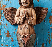 Angel on blue wooden wall by Garry Gay