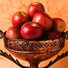 Brass bowl with fuji apples by Garry Gay