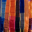 Brightly coloured egyptian scarves on display by Sami Sarkis