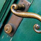 Ornate handle on green door by Sami Sarkis