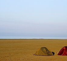 Tents on beach by Sami Sarkis